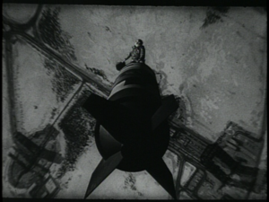 300px-Dr._Strangelove_-_Riding_the_Bomb.png
