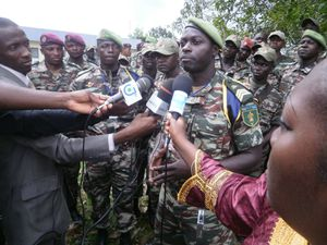 A Cameroonian soldier explains to the press what their trai