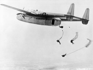 795px-Paratroopers jump from a C-82