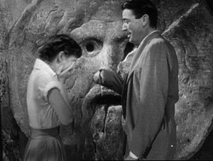 Audrey Hepburn and Gregory Peck at the Mouth of Truth Roman