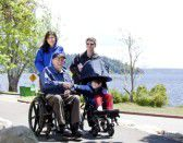 14505761-family-with-disabled-senior-and-child-walking-outd.jpg