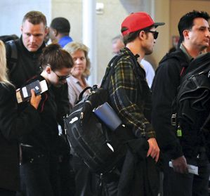 Robert Pattinson + Kristen Stewart leaving LA 2
