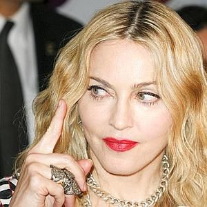 Madonna brings her boy toys to Kabbalah
