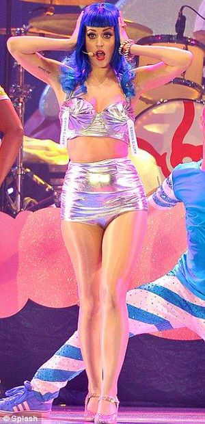 Katy Perry in a silver Madonna-inspired cone bra on stage