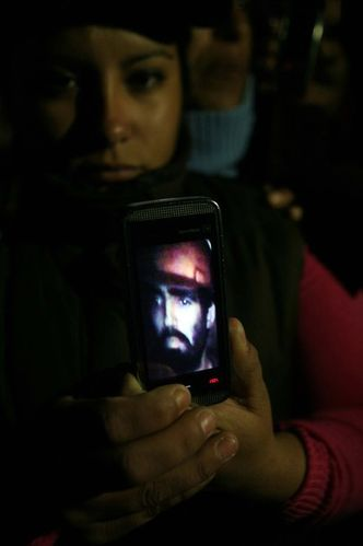 Relatives show a video recorded with a camera in a probe