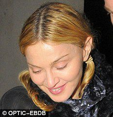 Madonna wears pigtails for dinner in London