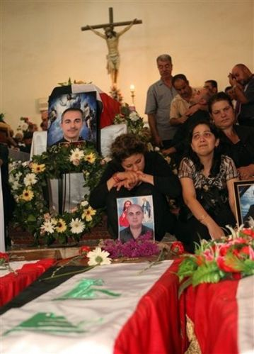 Christians at a funeral mass in Baghdad
