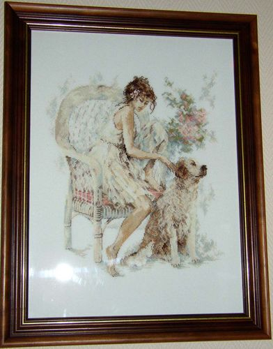 Girl in chair with dog Lanarte-