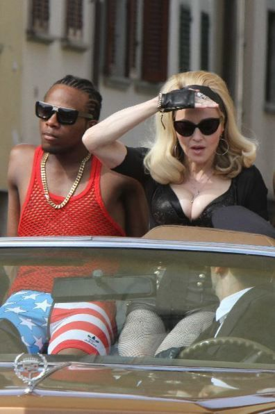 20120618-pictures-madonna-turn-up-the-radio-set-49