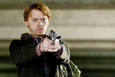 Rupert-Grint-Tony-determinedly-pointing-gun-in-the-car-park