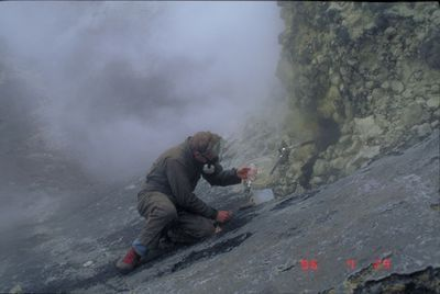 Akutan - CVO collecting gas samples in the crater - G.McGim