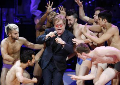 Elton John performs Madonna's ''Like A Virgin'' at Rainforest concert