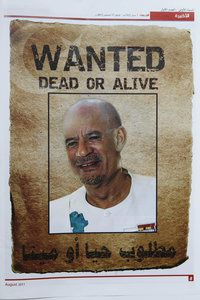 768802_a-wanted-poster-of-muammar-gaddafi-published-in-a-ne.jpg