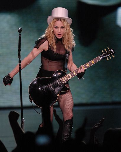 Madonna strums and struts for fans at the United Center