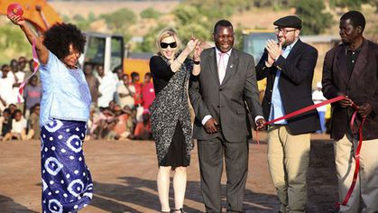 Madonna cuts the ribbon at a ground-breaking ceremony