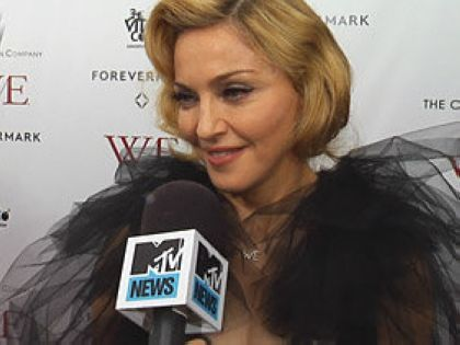 Madonna calls M.D.N.A. 'Action-Packed'