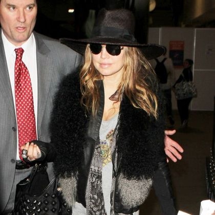 Fergie from Black Eyed Peas looks like Madonna arriving at LAX