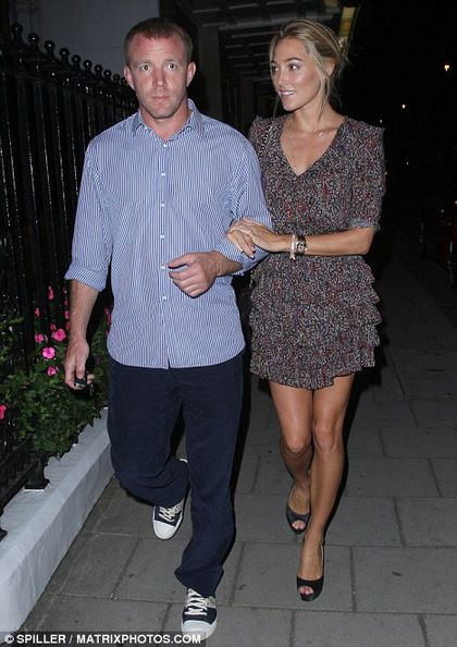 Guy Ritchie and Jacqui Ainsley in London on August 10, 2010