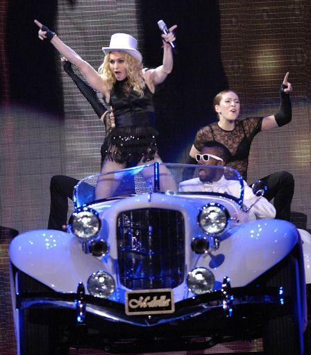 Madonna puts on a show, including a car, for fans at the United Center