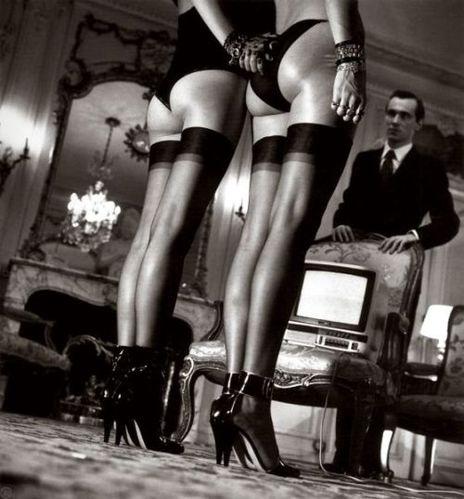 Helmut Newton Two Pairs Of LegsIn Black Hose