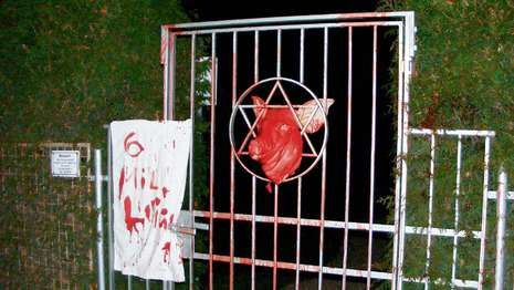 The jewish cemetery and the pig's head