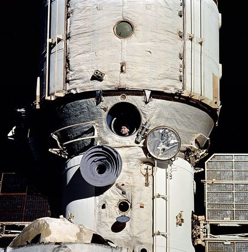 591px-Cosmonaut Polyakov Watches Discovery's Rendezvous Wit