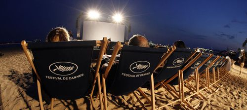 714303_spectators-await-the-start-of-a-beach-front-cinema-s.jpg