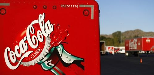660358 a-coca-cola-logo-is-displayed-on-a-truck-parked-outs
