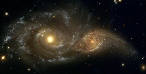 fusion-galaxies-NGC-2207-et-2163--Hubble-.jpg