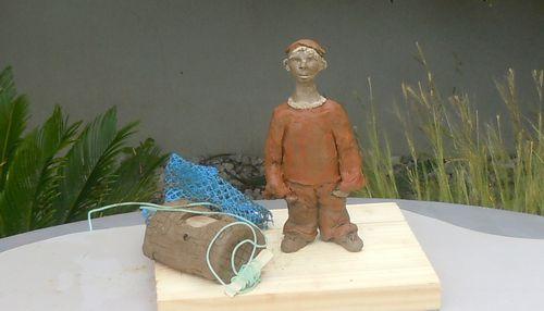 Kémo le petit pêcheur.Sculpture personnage.