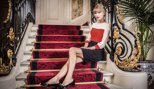 taylor-swift-the-lucky-one-lyrics-red-stairs-blonde-bangs.jpg