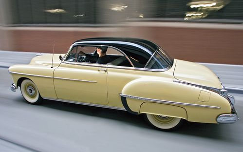 c12_0612_03z-1950_oldsmobile_futuramic_88-rear_side_driving.jpg