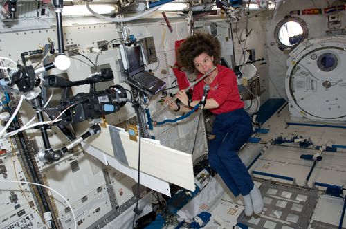 ISS27_Catherine_Coleman_plays_a_flute.jpg