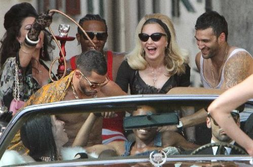 20120618-pictures-madonna-turn-up-the-radio-set-54
