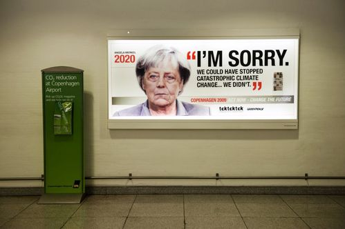 1-an-advertising-billboard-depicts-german-chancellor-angela.jpg