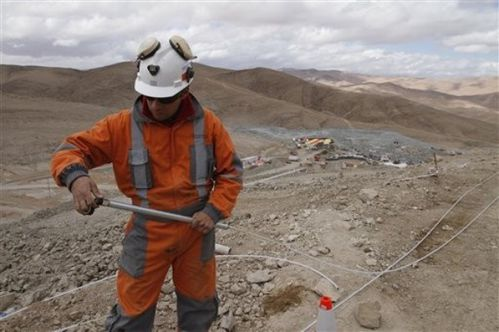 A worker prepares a tool to be used in the rescue operation