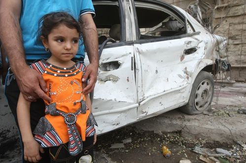 next to her father's destroyed vehicle