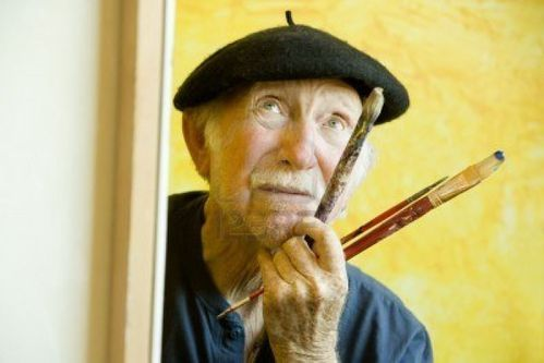 3108951-elderly-painter-wearing-a-beret-working-on-a-large-.jpg