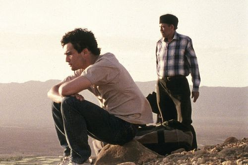 father and son in desert
