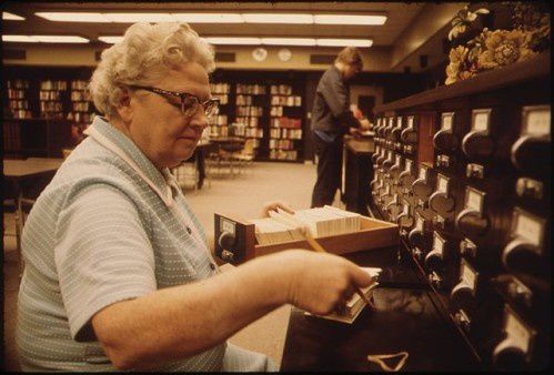 640px-LIBRARIAN AT THE CARD FILES AT SENIOR HIGH SCHOOL IN