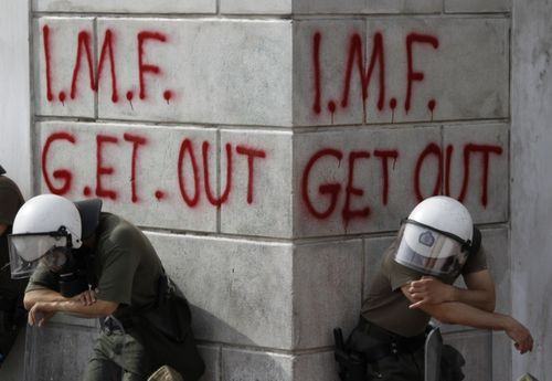 482516_greek-riot-policemen-rest-in-front-of-graffiti-durin.jpg