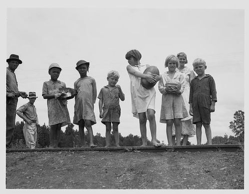 sharecroppers-children-gather-food-for-their-4th-of-july-ce.jpg