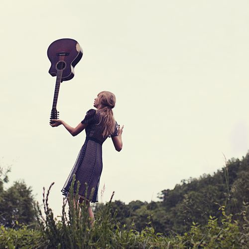 taylor-swift-state-of-grace-red-nature-guitar-balance.jpg