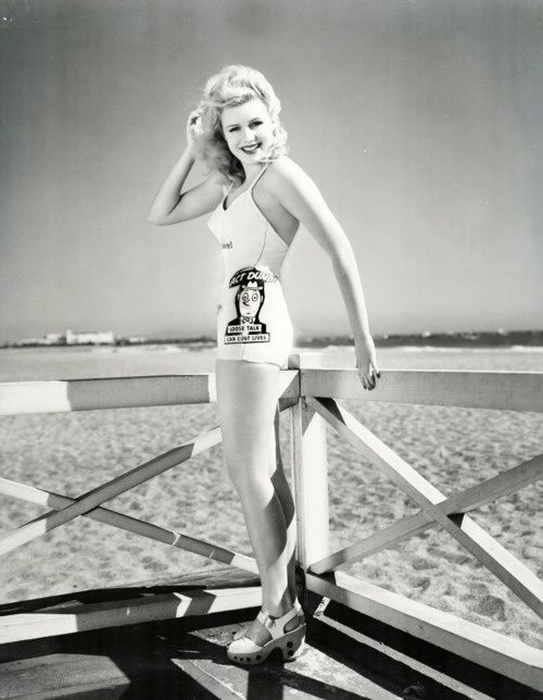 Majorie Woodworth wears a WW2 propaganda swimsuit that rea