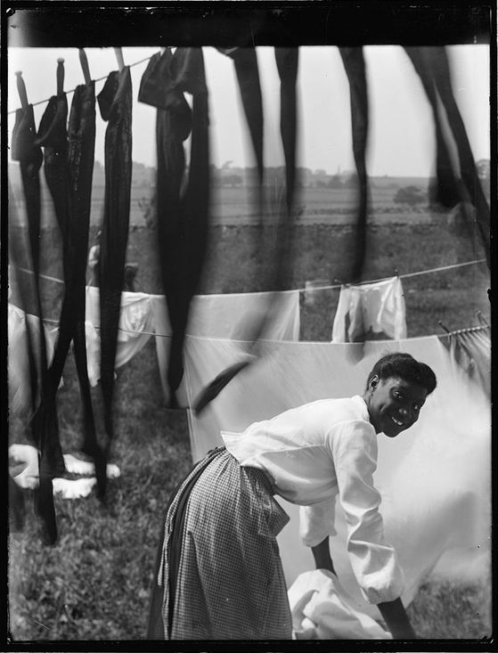 Black-and-White---Portrait-of-a-Negro-Woman-Doing-Laundry--.jpg