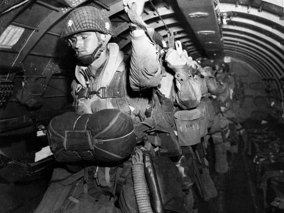 U.S.-paratroopers-fix-their-static-lines-before-a-jump-befo.jpg