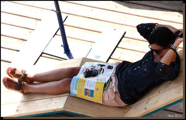 relaxing under sunshade