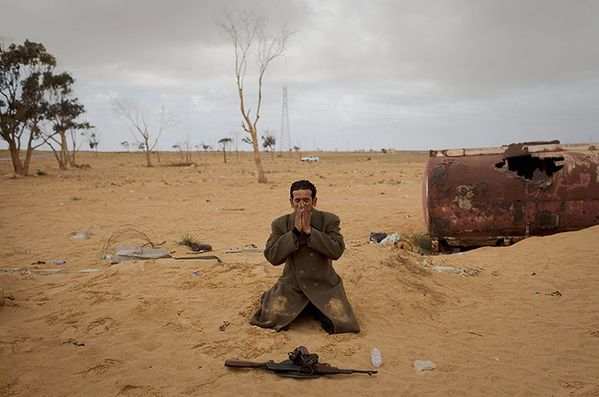 A-Libyan-rebel-prays-next-011.jpg