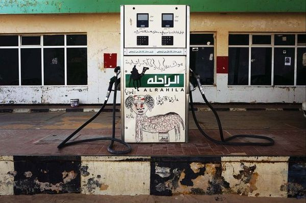 58682_a-fuel-pump-is-defaced-with-a-gaddafi-caricature-in-r.jpg