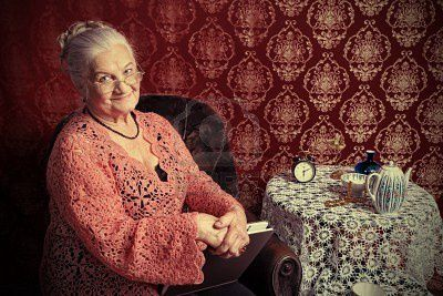 9074227-portrait-of-a-smiling-senior-woman-having-a-rest-at.jpg